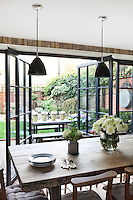 A neat row of flower pots can be seen through the patio doors of Kally Ellis's kitchen