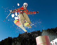 NEWS&amp;GUIDE PHOTO / PRICE CHAMBERS.Local shredder Charlie Hawks, 17, takes off from a jump at Jackson Hole Moutain Resort on Saturday, opening day for the season. Despite the area's lack of snowfall the ski area is blowing enough of the white precipitate to open Apres Vous and Teewinot lifts and has constructed two small terrain parks with several jumps and rails.