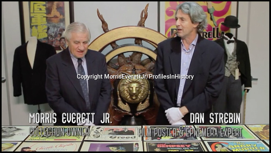 BNPS.co.uk (01202 558833)<br /> PIc: MorrisEverettJr/ProfilesInHistory/BNPS<br /> <br /> ***Please Use Full Byline***<br /> <br /> Morris Everett Jr (left) and Dan Strebin, film poster and ephemera expert at Profiles in History.<br /> <br /> The world's largest collection of movie posters boasting artwork from almost every single film made in the last century has emerged for sale for &pound;5 million.<br /> <br /> The colossal archive features 196,000 posters from more than 44,000 films, and has been singlehandedly pieced together by one avid collector over the last 50 years.<br /> <br /> Morris Everett Jr has dedicated his life's work to seeking out original posters from every English-speaking film ever made and compiling them into a comprehensive library.<br /> <br /> The sale is tipped to make $8 million - around &pound;5 million pounds - when it goes under the hammer in one lot at Califonia saleroom Profiles in History on December 17.