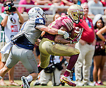 Travis Rudolph makes a 21 yard touchdown reception and run in the first half of Florida State's 52-8 win over Charleston Southern in their NCAA football game at Doak Campbell Stadium in Tallahassee Florida September 10, 2016.  Rudolph had 7 receptions for 105 yards and two touchdowns against the Buccaneers.