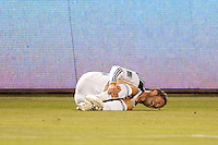 David Beckham (23) of the Galaxy withers in pain after being taken down by Thierry Henry. The LA Galaxy and Red Bulls of New York played to a 1-1 tie at Home Depot Center stadium in Carson, California on  May 7, 2011....