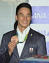 Japanese Olympic Swimming Medalists return to Japan