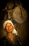 Elderly Nage Keo woman, with traditional drums. Ua village, near Boawae, Flores, East Nusa Tenggara, Indonesia.