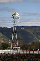 A windmill stands above a vineyard in Oakville in Napa County in Northern California.