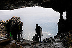 Stock photo of Divers at a cavern preparing to deep into the Mediterranean sea water Cape Gkreko Cyprus