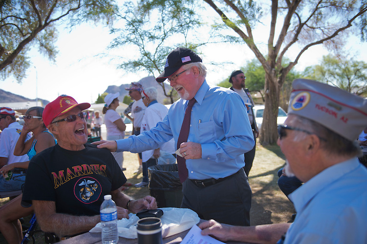 UNITED STATES - MAY 28:  Ron Barber, center, democratic candidate in the AZ-08 special election, talks with Raymond McDonell, 90, a WWII vet, during a Memorial Day ceremony in Tucson, Ariz.  The winner of the election between Barber and republican Jesse Kelly on June 12th, will fill the seat occupied by former Rep. Gabrielle Giffords, D-Ariz.  (Photo By Tom Williams/CQ Roll Call)
