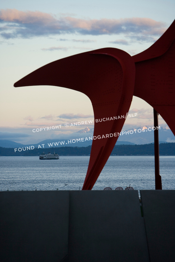 "With the snow-capped Olympic Mountains looming some 40+ miles away, the iconic shape of Alexander Calder's, ""Eagle, 1971"" stands silhouetted against a Northwest sunrise.  SAM's Olympic Sculpture Park, Seattle, WA."