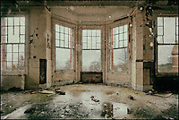 Interior of derelict mental asylum with windows, processed to emulate wet plate technique.
