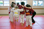 Albany CA Mixed age children rallying together before a Tae Quan Do demonstration