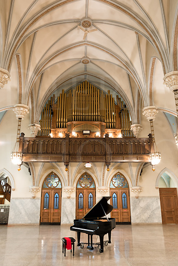 A huge Gothic church that has been converted into a social hall and concert venue is featured in this image along with its resident black grand piano, waiting for the moment when someone will play it. The high vaulted ceiling with arches and the three door symmetry focus the eye on the battery of large organ pipes in the choir loft...here is some genuine and grand beauty in religious architecture. <br /> <br /> This old Catholic church building itself dates from 1908 and was originally a German immigrant parish in the Cambria City section of Johnstown, PA. There were once many Catholic churches in that one small section of the city, so in recent times of reduced population the diocese consolidated the parishes and sold the buildings, some of which were gathered up by a preservation society called The Steeples Project who now run this rental hall. For information about them and this very beautiful building, go to http://www.steeplesproject.org<br /> <br /> Monthly Newsletter sign up at Dierks Photo on Facebook...