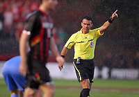 COLLEGE PARK, MD - OCTOBER 19, 2012:  Referee Chico Grajeda in the rain during an ACC match between Maryland and North Carolina at Ludwig Field in College Park, MD on October 19. Maryland won 1-0 AET.