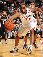 Dec. 22, 2010; Charlottesville, VA, USA; Virginia Cavaliers forward Mike Scott (23) reaches for a loose ball in front of Seattle Redhawks guard Cervante Burrell (5) during the game at the John Paul Jones Arena. Seattle Redhawks won 59-53. Mandatory Credit: Andrew Shurtleff