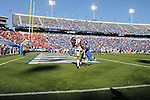 Ole Miss' Donte Moncrief (12) catches an apparent touchdown pass as Kentucky's Anthony Mosley (14) defends, which was negated by a offensive pass interference call, at Commonwealth Stadium in Lexington, Ky. on Saturday, November 5, 2011. Kentucky won 30-13...