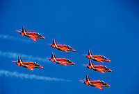 Red Arrows aerobatic team in flying formation over RAF Scampton, Lincolnshire, UK in BAE Systems Hawk T1 aircraft with Rolls Royce engines