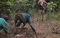 Aborigines learn to collect crocodile eggs, keeping their native culture intact. The day before we had gathered about 140 eggs from 3 nests and the croc had slithered off before we got there.  Aborigines just use a big stick or paddle to defend themselves from charging crocodiles.
