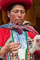 Quechua woman works wool into yarn, Cusco Peru, South America