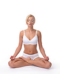 Young woman meditating in Lotus pose with closed eyes