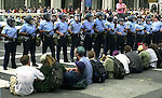 (MAGAZINES PLEASE CALL) Protesters sit on the ground, and lock arms, causing a temporary standoff with Philadelphia Police, during a protest in support of convicted cop killer Mumia Abu Jamal, Aug. 1, 2000, in Philadelphia on the second day of the Republican National Convention. Protesters committed various acts of civil disobedience, bringing traffic in Center City Philadelphia to a crawl for most of the afternoon. Over 300 people were arrested. (Photo by William Thomas Cain/Photojournalist.cc)
