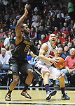 Mississippi's Marshall Henderson (22) drives against Missouri's Keion Bell (5) at the C.M. &quot;Tad&quot; Smith Cliseum on Saturday, January 12, 2013. (AP Photo/Oxford Eagle, Bruce Newman)