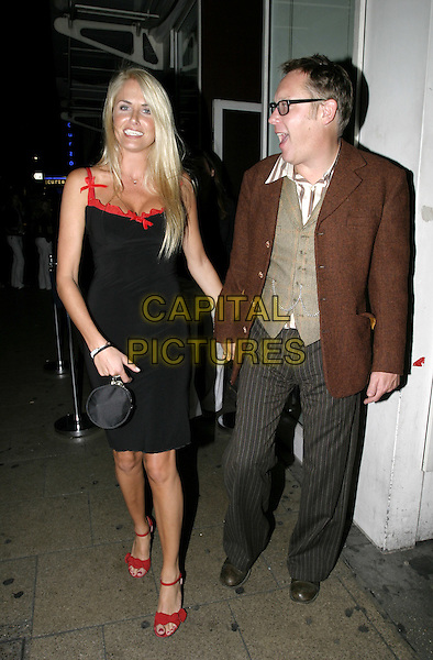 NANCY SORRELL & VIC REEVES.One Flew Over The Cuckoo's Nest - West End Transfer & Press Night.September 17th, 2004.full length, husband, wife, married, black dress, red trim, red shoes, little black bag, purse.www.capitalpictures.com.sales@capitalpictures.com.© Capital Pictures.