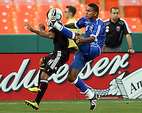 Andy Najar #14 of D.C. United loses the ball to a high kick from Carlos Monteagudo of El Salvador during an international charity match at RFK Stadium, on June 19 2010 in Washington DC. D.C. United won 1-0.
