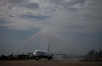 "SANTA CLARA, CUBA - AUGUST 31 : Firetrucks spray water over JetBlue plane, ""baptizing"" the first commercial flight between the US and Cuba during the arrival of  inaugural flight at Abel Santamaría Airport on August 31, 2016 in Santa Clara, Cuba. Photo by VIEWpress"