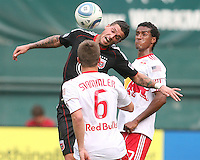 Santino Quaranta #25 of D.C. United wins a header from Roy Miller #7 of the New York Red Bulls during an MLS match on May 1 2010, at RFK Stadium in Washington D.C.