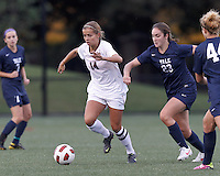 Harvard University midfielder/Defender Peyton Johnson (14) dribbles as Yale University midfielder Shannon Conneely (23) closes. In overtime, Harvard University defeated Yale University,1-0, at Soldiers Field Soccer Stadium, on September 29, 2012.
