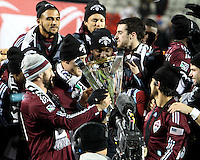 Clorado players look at the trophy During post game trophy Celebration after MLS Cup 2010 at BMO Stadium in Toronto, Ontario on November 21 2010.