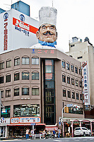 """Giant chefs head sticking out of building in Tokyo`s Kappabashi district - know as """"kitchen tool town""""."""