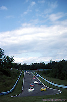 A group of cars during the 1984 IMSA race at Watkins Glen, New York.