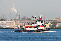 Tugboat Captain D in Newark Bay, with the Singer Sewing machine factory in the background.