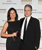 Washington, DC - December 5, 2009 -- Jon Stewart and Tracy Stewart arrive for the formal Artist's Dinner at the United States Department of State in Washington, D.C. on Saturday, December 5, 2009..Credit: Ron Sachs / CNP.(RESTRICTION: NO New York or New Jersey Newspapers or newspapers within a 75 mile radius of New York City)