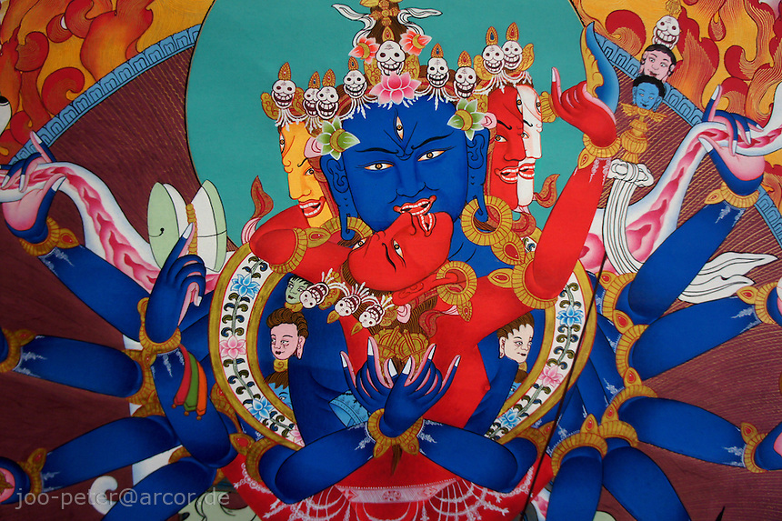 close-up thanka-painting of  Bhairab (fierceful tantric incarnation of Shiva) with female shakti called Bajra Yogini, Himalaya, Nepal, October 2011. Tantric buddist tradition in Nepal can be found in higher Himalaya mountai areas like Mustang,  influenced by tantric tibetan buddhist traditions. Here examples of Thanka-paintings as sold by contemporary traditional artists.