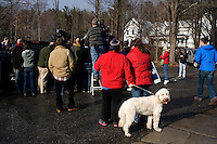 Locals stand at the periphery of the action at a Rick Santorum campaign stop at Pelletier's Sports Shop in Jaffrey, New Hampshire, on Jan. 6, 2012.  Santorum is seeking the 2012 GOP Republican presidential nomination.