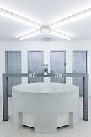 Minimalist modern Gents lavatory toilets and wash basin at Arken Museum of Modern Art, nr Copenhagen, Denmark