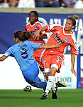 Homare Sawa (8) holds onto Tisha Venturini-Hoch (15) at Herndon Stadium in Atlanta, GA on 5/17/03 during a game between the Atlanta Beat and San Jose CyberRays. Atlanta won the game 1-0.