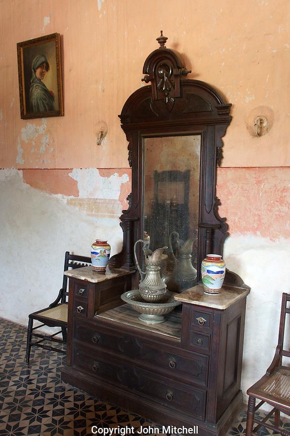 Colonial era antique dresser in the main building at Hacienda Yaxcopoil, Yucatan, Mexico.