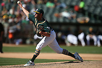 OAKLAND, CA - SEPTEMBER 10:  Chris Smith #56 of the Oakland Athletics pitches against the Seattle Mariners during the game at the Oakland Coliseum on Saturday, September 10, 2016 in Oakland, California. Photo by Brad Mangin