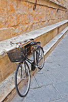 Bicycle parked along wall, Pienza, Italy, Tuscany.