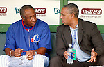 10 September 2003: Montreal Expos Hall of Fame Manager Frank Robinson listens to General Manager Omar Minaya about team matters in the dugout prior to a game against the Chicago Cubs at Hiram Bithorn Stadium, in San Juan, Puerto Rico. The Montreal Expos plaed 22 of their scheduled home games in Puerto Rico as part of a revenue generating promotion by MLB. Mandatory Credit: Ed Wolfstein Photo