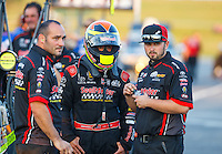 Sep 23, 2016; Madison, IL, USA; NHRA top fuel driver J.R. Todd (center) with crew members during qualifying for the Midwest Nationals at Gateway Motorsports Park. Mandatory Credit: Mark J. Rebilas-USA TODAY Sports