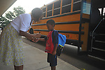 Teacher Sondra Brown (left) helps student Jamarian Wadley on the first day of school at Bramlett Elementary in Oxford, Miss. on Thursday, August 4, 2011.