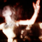 A woman in ecstatic pose gazes with outstretched arms.