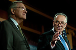 Senate Majority Leader HARRY REID (D-NV) listens as Senator CHUCK SCHUMER (D-NY) speaks during news conference on disaster relief funding on Capitol Hill on Thursday.