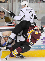 San Antonio Rampage's Alex Petrovic (3) takes down Chicago Wolves' Nicklas Jensen during the first period of an AHL playoff hockey game, Saturday, April 21, 2012, in San Antonio. (Darren Abate/pressphotointl.com)