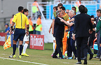 A member of the Italian backroom staff is held back by Uruguay coach Oscar Tabarez as he shouts at the assistant referee following Uruguay's winning goal