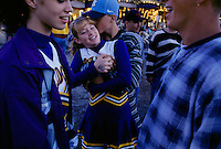 """After participating in the cheerleader contest, teens meet their boyfriends in the midway to cuddle at the Cullman County Fair in Alabama. Texas fair manager Anita Rogers says, """"Many young hearts have been stolen at a county fair."""""""