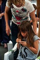 Roma 9 Giugno 2012 .Giornata Mondiale della Maglia in Pubblico in piazza San Cosimato,nel quartiere  di Trastevere,con workshop di maglia e social Knitwork a cura della Banda della Maglia..Word Wide Knit in Public Day.