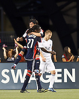 New England Revolution midfielder Shalrie Joseph (21) celebrates his goal with New England Revolution midfielder Lee Nguyen (24). In a Major League Soccer (MLS) match, the New England Revolution defeated Vancouver Whitecaps FC, 4-1, at Gillette Stadium on May 12, 2012.